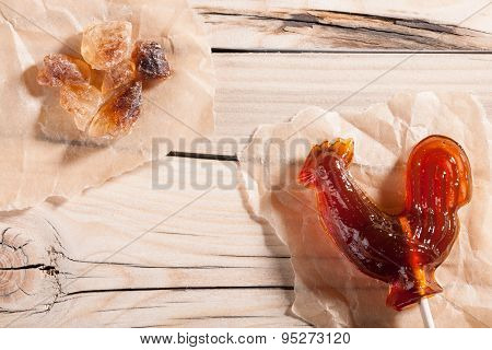 Candy And Rock Sugar On Wooden Background