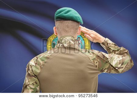 Soldier Saluting To Usa State Flag Conceptual Series - Idaho