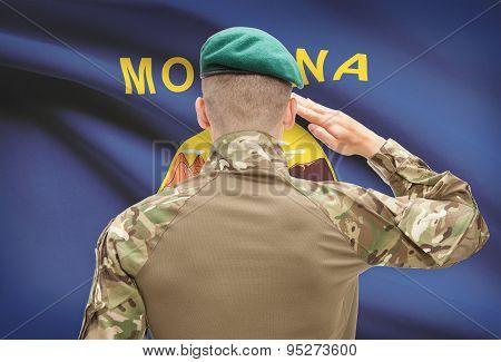 Soldier Saluting To Usa State Flag Conceptual Series - Montana
