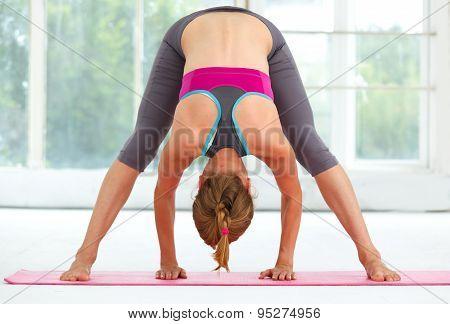 Young Beautiful Woman Doing Yoga.