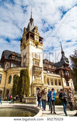 Tourists Walking Near The Former Royal Peles Castle, Sinaia, Romania