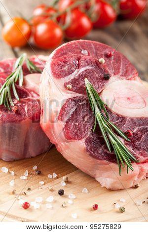 Raw Beef T-bone Steak And Fresh Tomatoes