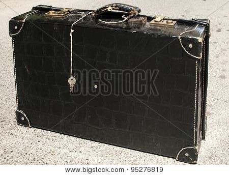 Suitcase of black patent leather