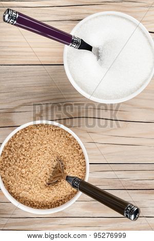 White And Brown granulated Sugar Closeup