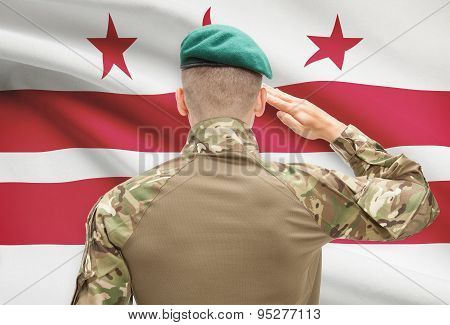 Soldier Saluting To Usa State Flag Conceptual Series - District Of Columbia