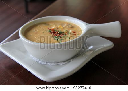 Hot,steaming bowl of creamy seafood chowder