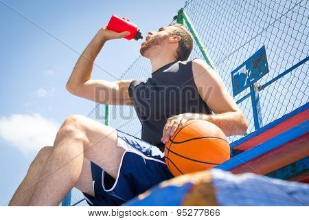 young man in basketball field