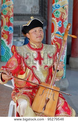 Man performs music with morin khuur - national musical instrument in Ulaanbaatar.