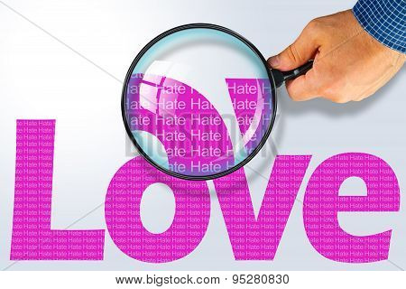 Love - Hate Opposite Message, Hand Holding Magnifying Glass