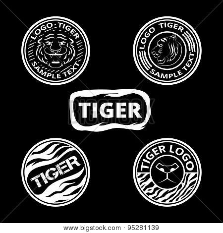Set of logos with tigers, striped icons and lagels. Graphic roun