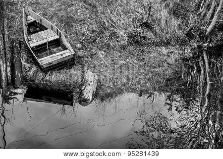 Old Wooden Fishing Boat On Lake Coast