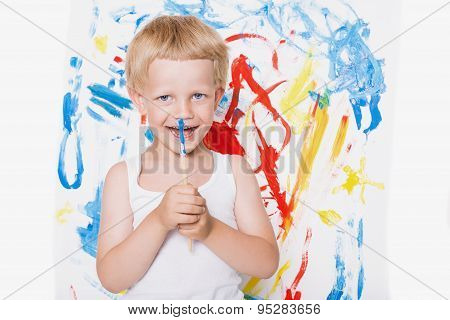 Artist preschool boy painting brush watercolors on a easel. School. Education. Creativity