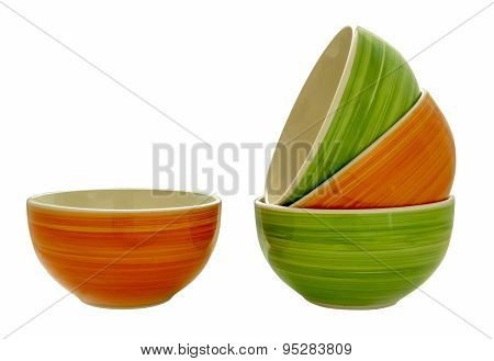 Green And Orange Bowls Stacked On Each Other, Forming A Cascade.