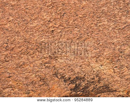 Background close-up of orange red dolomite rock
