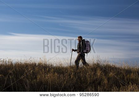 Female hiker walks along the ridge
