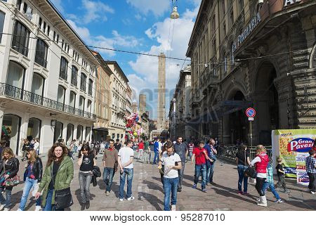 People walk by the Francesco Rizzoli street in Bologna, Italy.