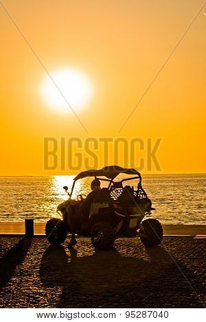 Quad Motorbike By The Sea At Sunset