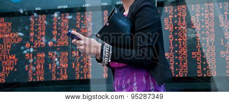 Trading Stock On Mobile Near Exchange Board