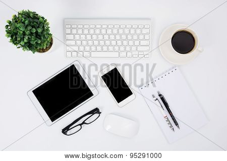 Business Desk With A Keyboard, Mouse And Pen