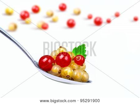 Red and yellow currants in spoon