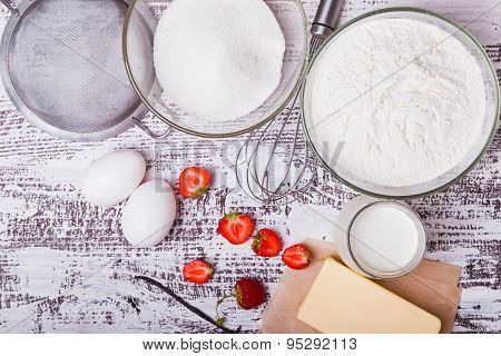 Ingredients For Making Strawberry Yogurt Cake On White Wooden Background