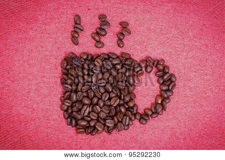 A Cup Of Coffee Make From Coffee Beans On Red Cloth Background