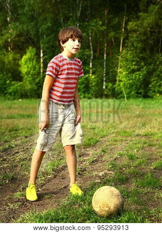 preteen handsome  boy play soccer on the open air field