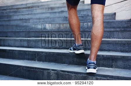 Sport, Fitness And Healthy Lifestyle Concept - Man Running In The City, Feet Of Male Runner On Steps