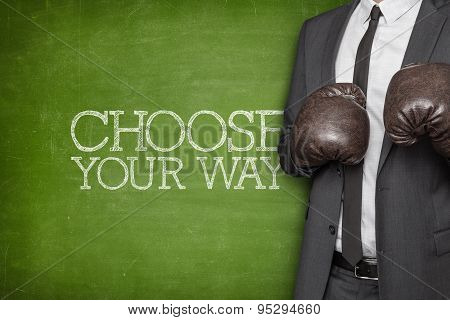Choose your way on blackboard with businessman