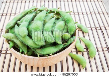 Fresh Green Soybeans In Wooden Bowl