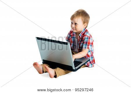 Boy In A Plaid Shirt With A Laptop On A White Background.