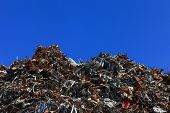 foto of scrap-iron  - Scrap metal yard with clear blue sky - JPG