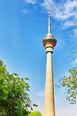 stock photo of cctv  - CCTV tower against a blue sky in capital of ChinaBeijing - JPG