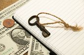 picture of memento  - Opened notebook with a blank sheet key and money on the old tissue - JPG