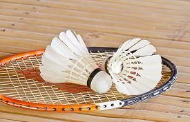 foto of shuttlecock  - shuttlecock with racket on bamboo table  - JPG