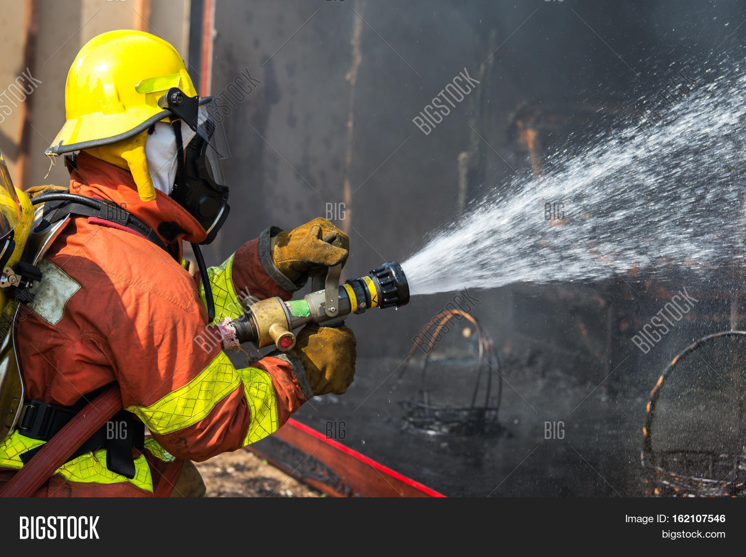 Firefighter Hold And Adjust Nozzle And Fire Hose Spraying