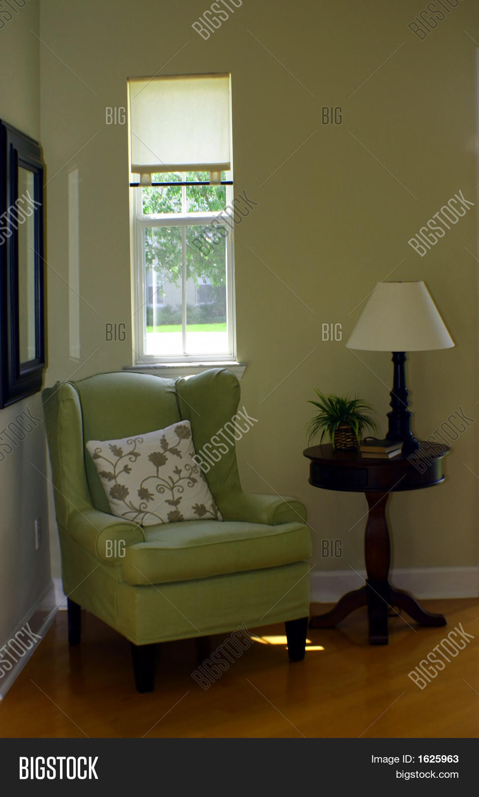Green wingback chair and lamp in foyer stock photo & stock images ...