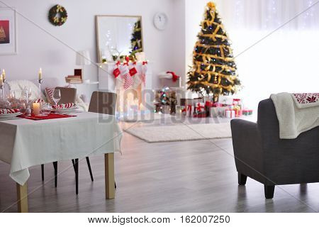 Table served for Christmas dinner in living room