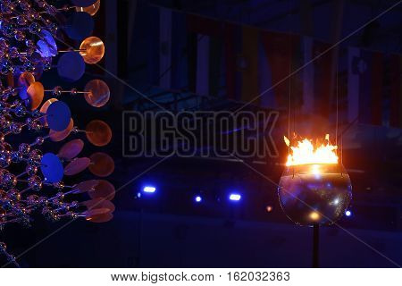 RIO DE JANEIRO, BRAZIL - AUGUST 5, 2016: The Olympic flame burns in the Maracana Olympic stadium during the opening ceremony of Rio 2016 Summer Olympic Games in Rio de Janeiro