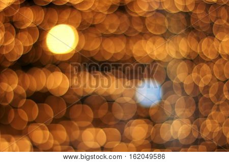 gold and blue blurred light on the background of many similar light spots / do not like everything