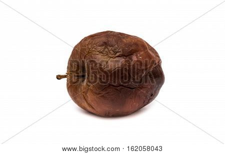 Rotten apple on white background. Dried apple