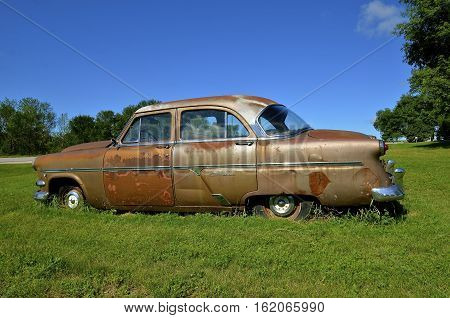 HAWLEY, MINNESOTA, August 4, 2016:  The old 1950's Ford Customliner Ford is a product of the Ford Motor Company located in Dearborn, Michigan started by Henry Ford and incorporated on June 16, 1903.