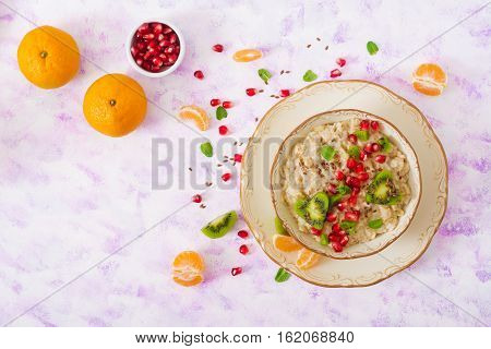 Tasty And Healthy Oatmeal Porridge With Fruit, Berry And Flax Seeds. Healthy Breakfast. Fitness Food