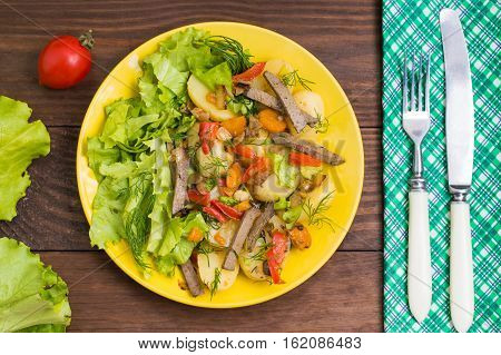 Salad from liver, carrots, potatoes peppers and lettuce