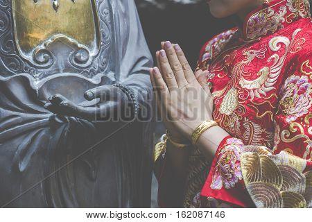 Woman hand respect to buddha statue. Sri Lanka