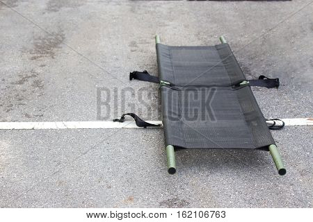 single light portable stretcher for medical evacuation or medevac for law enforcment tactical team isolated on road