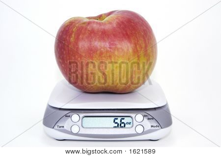 Apple On Scale With Imperial Display