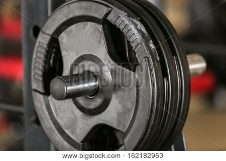 Rack with weight plates in gym, close up