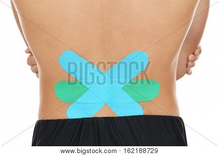 Physio tape on male lower back, close up