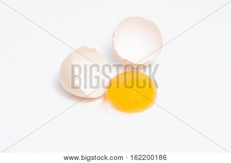 Eggs chicken bird with egg yolk and shell on a gray background